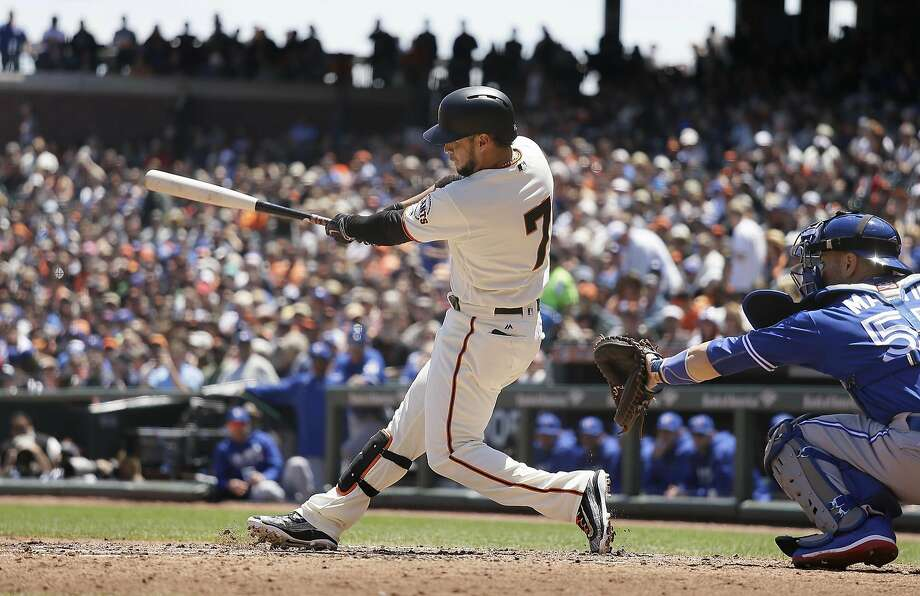 This Gregor Blanco swing in the second inning produced the elusive big hit for the Giants, a double that drove in one run and set up another. Photo: Eric Risberg, Associated Press