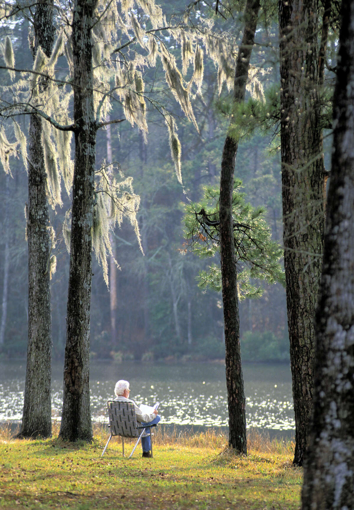 Relaxing under moss-draped trees around Lake Raven at Huntsville State Park, 50 miles north of Houston. The park draws about 400,000 visitors annually. Photo courtesy Texas Parks and Wildlife. date unknown.
