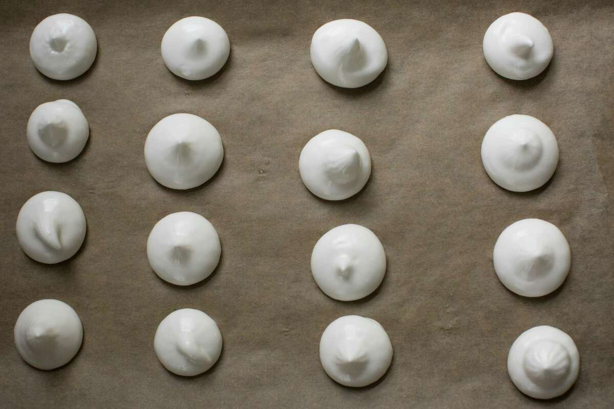 Aquafaba meringues before being baked, in Beacon, N.Y., May 3, 2016. Goose Wohlt, an Indiana software engineer who coined the name aquafaba, discovered in 2015 that chickpea liquid could be substituted for egg whites in a wide variety of recipes, winning over vegans and chefs alike. (Meredith Heuer/The New York Times)