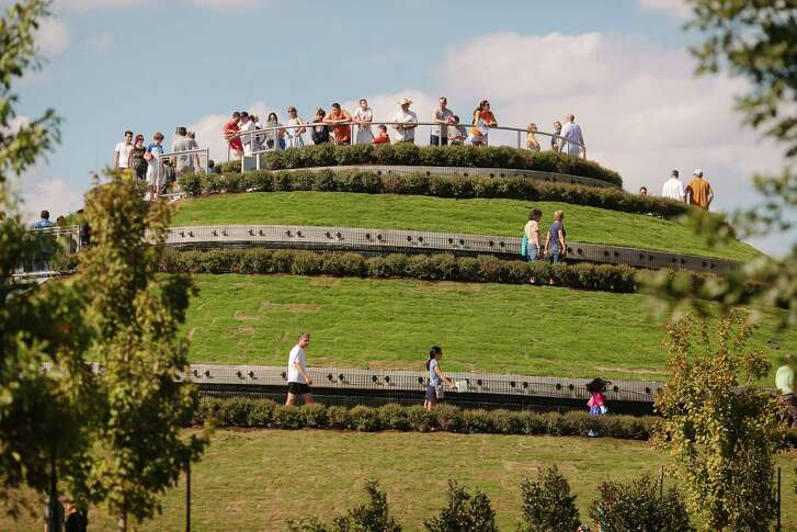 Visitors take in the views from the  30-foot-tall mount at McGovern Centennial Gardens in Hermann Park.