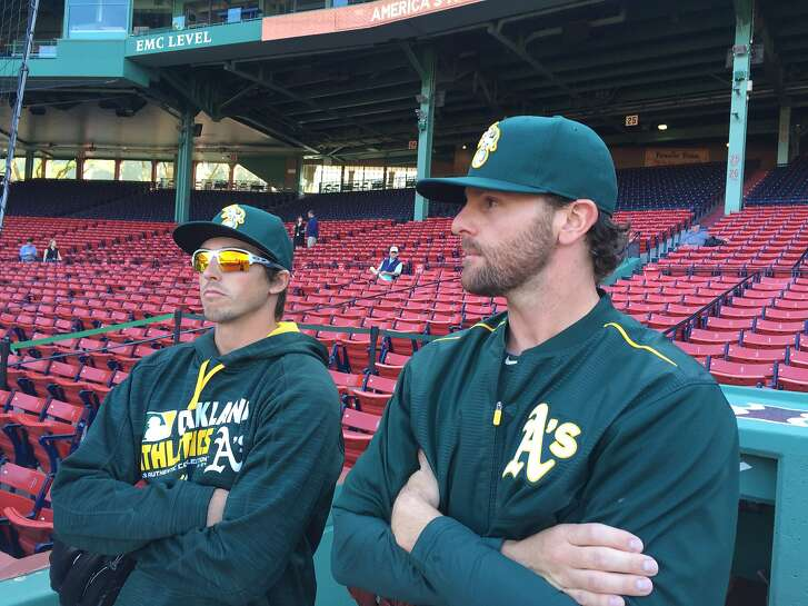 A pitcher Zach Neal, right, steps on the field at Fenway Park with reliever Ryan Dull before Oakland's game with Boston. Neal was called up for the first time Wednesday.