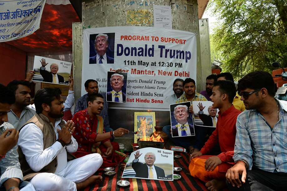 Right-wing Hindu activists in New Delhi perform a religious ritual in an attempt to help ensure victory for Donald Trump in the U.S. presidential race. Photo: SAJJAD HUSSAIN, AFP/Getty Images