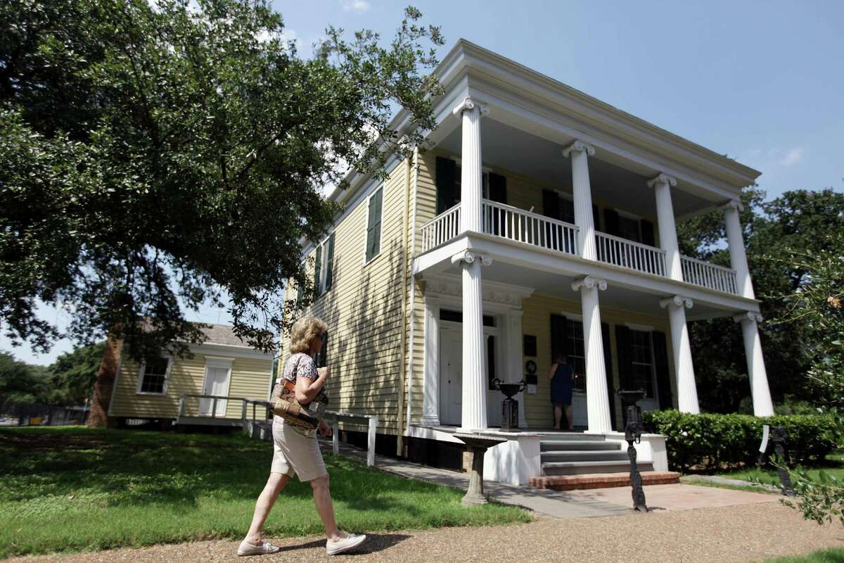 People visit the Nichols-Rice-Cherry House while tours offered during the Rice University's 100th Anniversary Celebration with the William Marsh Rice: The Man and His Legacy exhibit at The Heritage Society at Sam Houston Park on Sunday, Sept. 23, 2012, in Houston. The Nichols-Rice-Cherry House, a greek revival house built in 1850 by Glen Ebenezer Nichols at Congress and San Jacinto Street. Sold to W.M. Rice, a philanthropist, in 1856, and then bought by Mrs. E. R. Cherry in 1897. The William Marsh Rice: The Man and His Legacy exhibit will be open until Nov. 4, 2012. ( Mayra Beltran / Houston Chronicle )