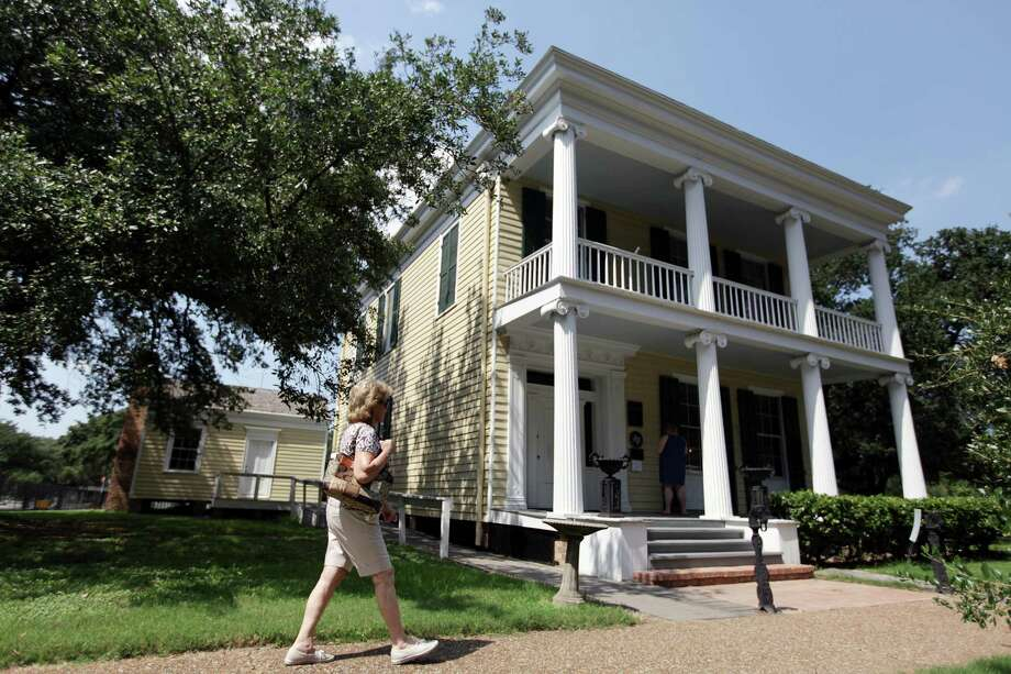 People visit the Nichols-Rice-Cherry House while tours offered during the Rice University's 100th Anniversary Celebration with the William Marsh Rice: The Man and His Legacy exhibit at The Heritage Society at Sam Houston Park on Sunday, Sept. 23, 2012, in Houston. The Nichols-Rice-Cherry House, a greek revival house built in 1850 by Glen Ebenezer Nichols at Congress and San Jacinto Street. Sold to W.M. Rice, a philanthropist, in 1856, and then bought by Mrs. E. R. Cherry in 1897.  The William Marsh Rice: The Man and His Legacy exhibit will be open until Nov. 4, 2012. ( Mayra Beltran / Houston Chronicle ) Photo: Mayra Beltran, Staff / © 2012 Houston Chronicle