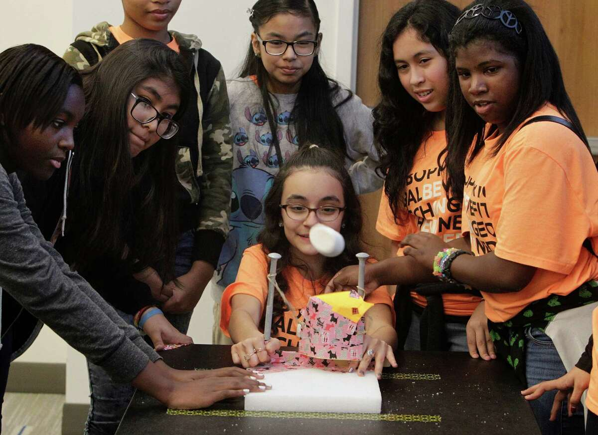 """Students at Houston's Stevenson Middle School use a catapault to launch a marshmallaow at """"Introduce a Girl to Engineering Day"""" in February. If Texas is to prosper in the 21st century, it must invest in STEM education."""