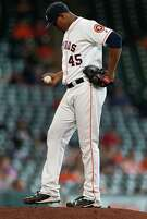 Houston Astros relief pitcher Michael Feliz (45) pitches during the fourteenth inning of an MLB baseball game at Minute Maid Park, Wednesday, May 11, 2016, in Houston.
