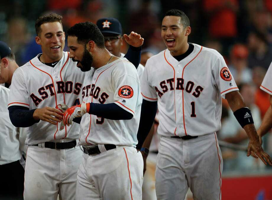 May 11: Astros 5, Indians 3 (16 innings)Houston Astros first baseman Marwin Gonzalez (9) is hugged by George Springer after his walk off home run during the sixteenth inning of an MLB baseball game at Minute Maid Park, Wednesday, May 11, 2016, in Houston. Photo: Karen Warren, Houston Chronicle / © 2016 Houston Chronicle
