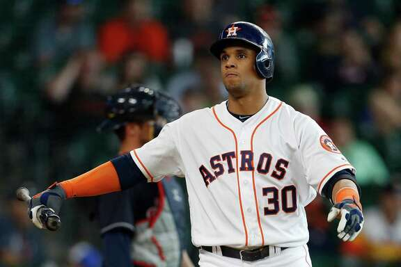 Houston Astros center fielder Carlos Gomez (30) reacts as he strikes out during the fourteenth inning of an MLB baseball game at Minute Maid Park, Wednesday, May 11, 2016, in Houston.