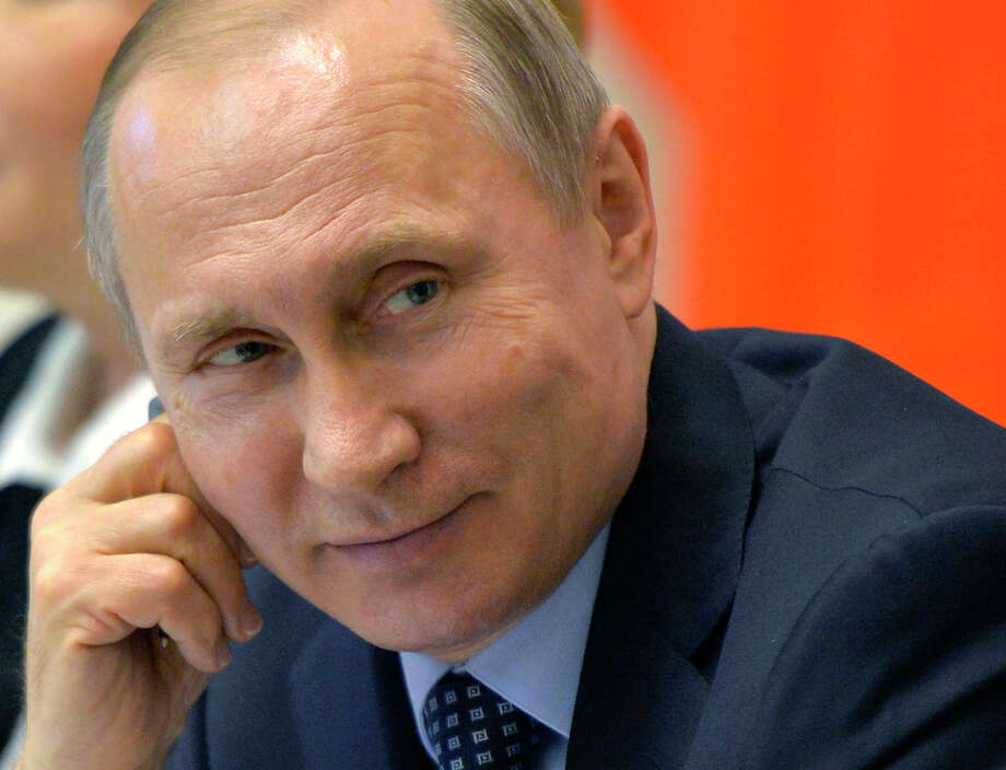 FILE - This is a Friday, April 29, 2016 file photo of Russian President Vladimir Putin as he attends a meeting with members of the Legislative Council in St. Petersburg, Russia. Monday May 9  Panama Papers release showed Russia as one of the top nations whose citizens are connected to offshore companies, which flies in the face of President Vladimir Putin's anti-offshore push calling on businessman to repatriate their businesses and money. (Alexei Druzhinin/Sputnik, Kremlin Pool Photo via AP) Photo: Alexei Druzhinin, POOL / POOL SPUTNIK KREMLIN