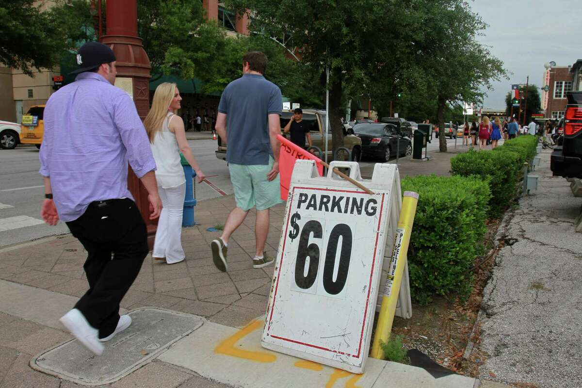 Parking can be at a premium in downtown Houston, especially during special events. A city project would put parking information on message signs to help direct drivers to optional spaces in private garages.