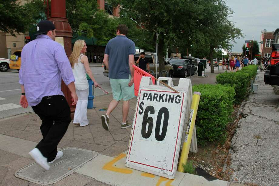 Parking can be at a premium in downtown Houston, especially during special events. A city project would put parking information on message signs to help direct drivers to optional spaces in private garages. Photo: Gary Fountain, Freelance / Copyright 2014 by Gary Fountain