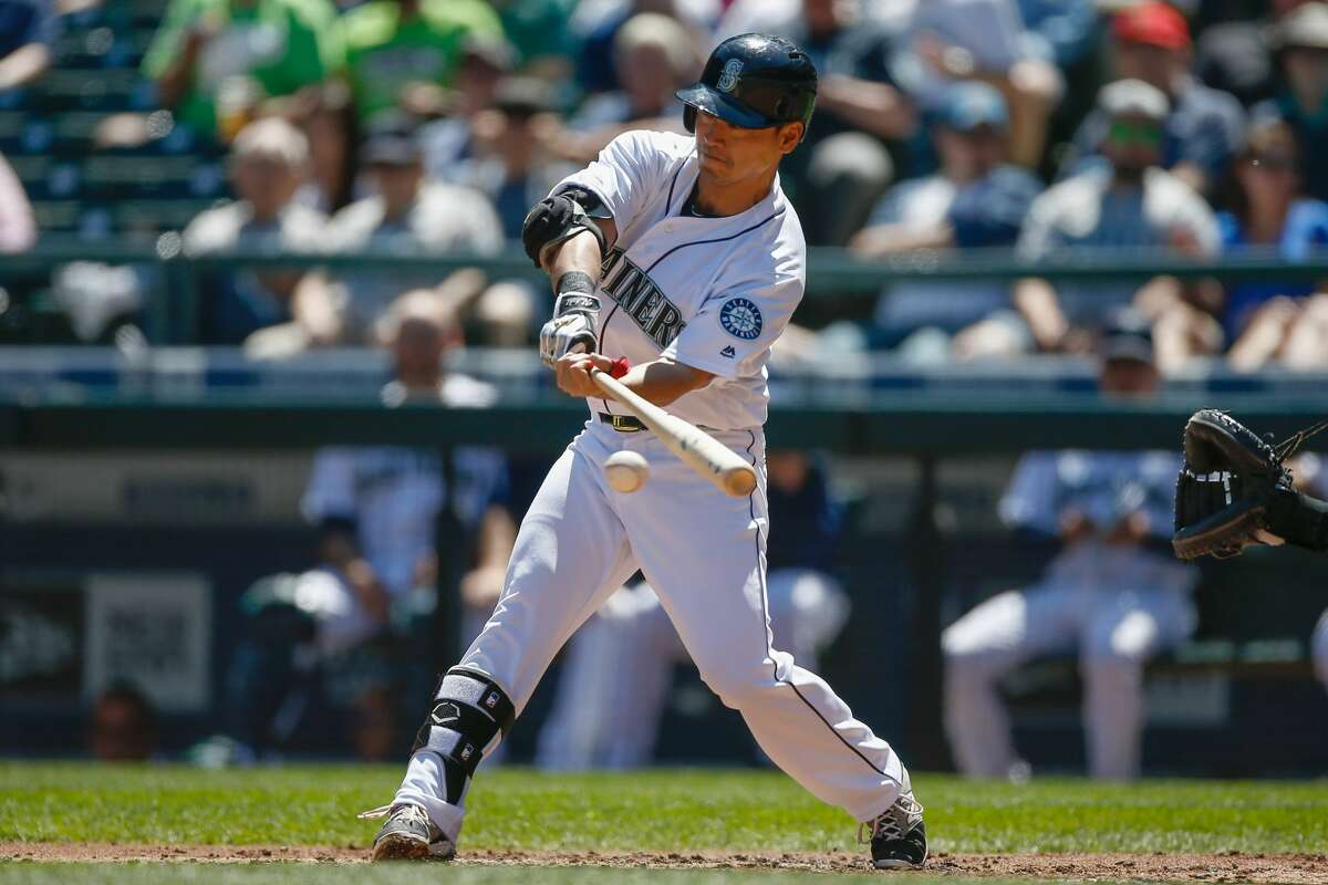SEATTLE, WA - MAY 11: Norichika Aoki #8 of the Seattle Mariners singles in the first inning against the Tampa Bay Rays at Safeco Field on May 11, 2016 in Seattle, Washington. (Photo by Otto Greule Jr/Getty Images)
