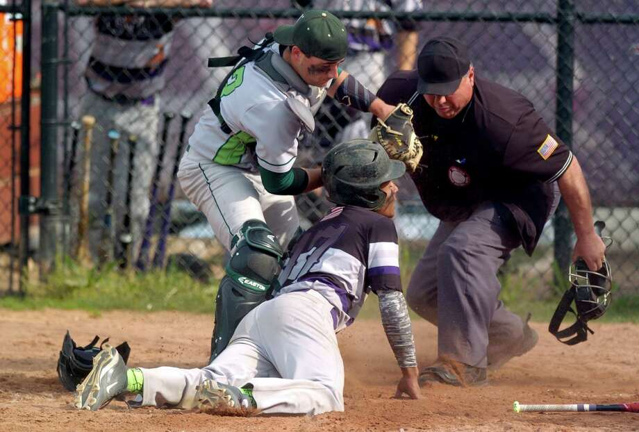 Norwalk catcher Marco Monteiro tags Westhill Tyrone Jeronimo out at homeplate in the second inning in a FCIAC baseball game at Westhill High Schooll on May 11, 2016. Photo: Matthew Brown, Hearst Connecticut Media / Stamford Advocate