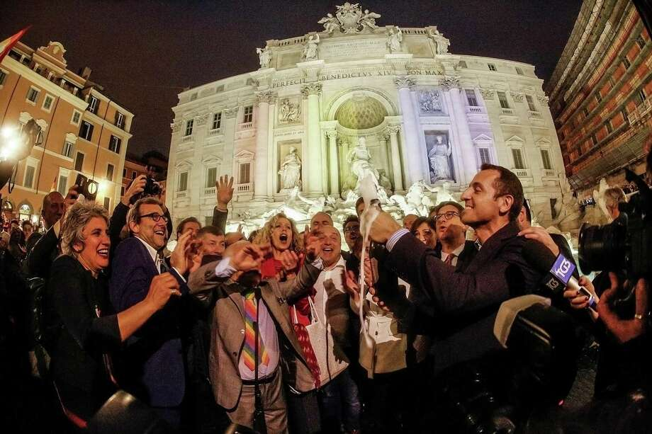 Gay rights activists celebrate at Rome's historic Trevi fountain after lawmakers granted same-sex couples many of the rights married couples have. Photo: Giuseppe Lami / Associated Press / ANSA