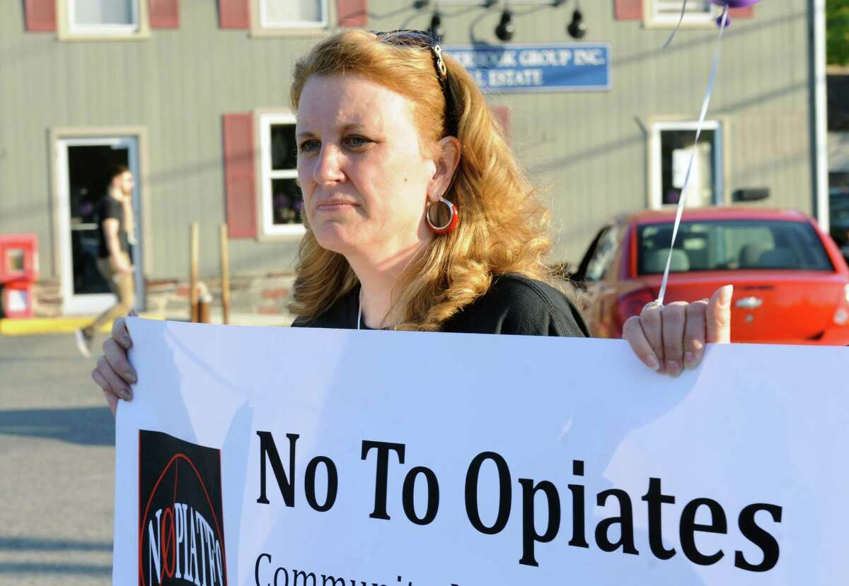 Lead by Kim Murdickmore than 100 participated in a memorial walk and candlelight vigil organized by the Averill Park Addiction Coalition on Wednesday May 11, 2016 in West Sand Lake, N.Y. (Michael P. Farrell/Times Union)