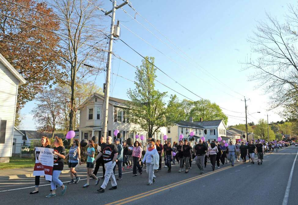 More than 100 participated in a memorial walk and candlelight vigil organized by the Averill Park Addiction Coalition on Wednesday May 11, 2016 in West Sand Lake, N.Y. (Michael P. Farrell/Times Union)