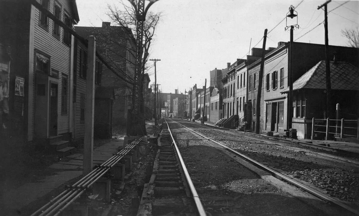 View looking south on 6th Ave from Jacob Street. The small building to the right that is the gatehouse is now the site of the Central Fire Station. (Rensselaer County Historical Society)