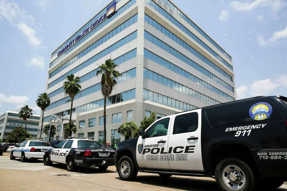 Police respond to the Community Health Choice building at 2636 South Loop West after a man who was visibly upset kicked in a door was shot by an employee on the fifth floor Wednesday. Photo: Michael Ciaglo, Staff / © 2016  Houston Chronicle