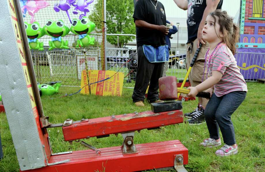 The opening night of the 100th annual Coleman Brothers Carnival in Shelton, Conn. on Wednesday May 11, 2016. The carnival, which benefits the Boys and Girls Club of the Lower Naugatuck Valley, will be open from 6-11 pm on weeknights, and from 1-11 pm on Saturdays and Sundays. The Boys & Girls Club will hold a ribbon cutting ceremony and will make a special presentation to Mayor Mark Lauretti at 2 pm on Saturday, May 14th. All are welcome to attend. Bring the family down and enjoy carnival rides, games of chance, and attractions for the young and the young at heart! For more information about the Boys & Girls Club of the Lower Naugatuck Valley, visit us at www.BGC-LNV.org. Photo: Christian Abraham, Hearst Connecticut Media / Connecticut Post