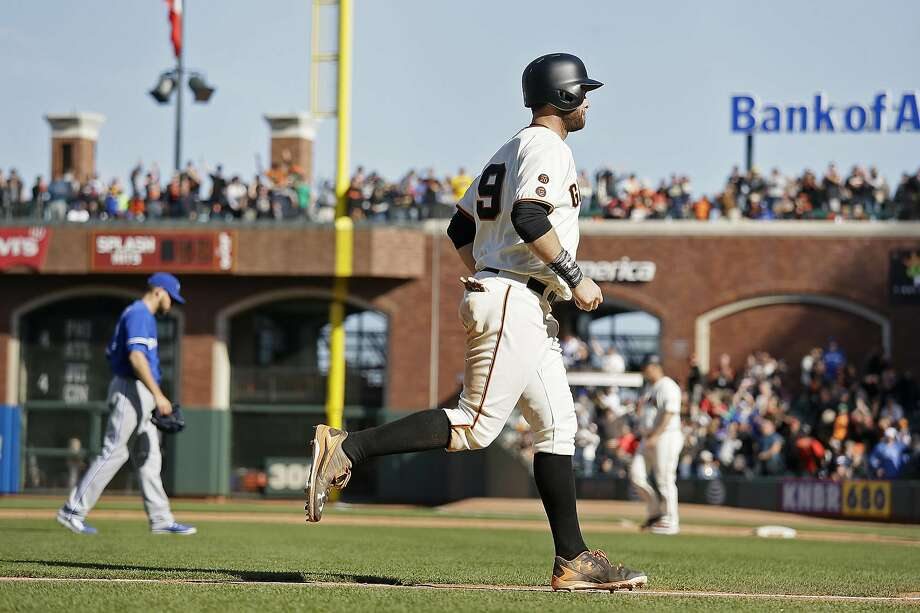 Brandon Belt ambles home with the winning run Wednesday, scoring on Buster Posey's 13th-inning walk. Photo: Eric Risberg, Associated Press
