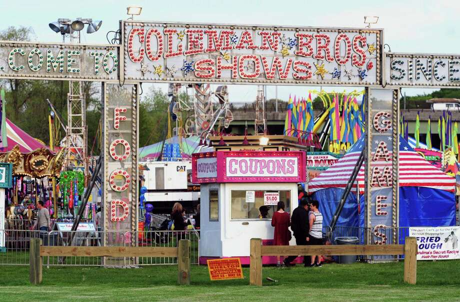 The opening night of the 100th annual Coleman Brothers Carnival in Shelton, Conn. on Wednesday May 11, 2016. The carnival, which benefits the Boys and Girls Club of the Lower Naugatuck Valley, will be open from 6-11 pm on weeknights, and from 1-11 pm on Saturdays and Sundays. The Boys & Girls Club will hold a ribbon cutting ceremony and will make a special presentation to Mayor Mark Lauretti at 2 pm on Saturday, May 14th. All are welcome to attend. Bring the family down and enjoy carnival rides, games of chance, and attractions for the young and the young at heart! For more information about the Boys & Girls Club of the Lower Naugatuck Valley, visit us at www.BGC-LNV.org. Photo: Christian Abraham / Hearst Connecticut Media / Connecticut Post