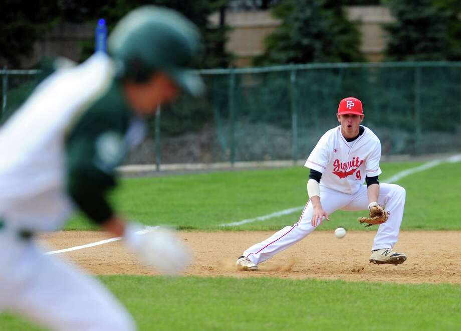 Fairfield Prep third baseman Will Lucas prepares to stops a Notre Dame of West Haven grounder during baseball action in Fairfield, Conn., on Wednesday May 11, 2016. Photo: Christian Abraham, Hearst Connecticut Media / Connecticut Post