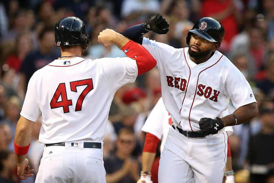 Jackie Bradley Jr. #25 celebrates with Travis Shaw #47 of the Boston Red Sox after hitting a three-run home run in the second inning during the game against the Oakland Athletics at Fenway Park on May 11, 2016 in Boston, Massachusetts. Photo: Adam Glanzman, Getty Images