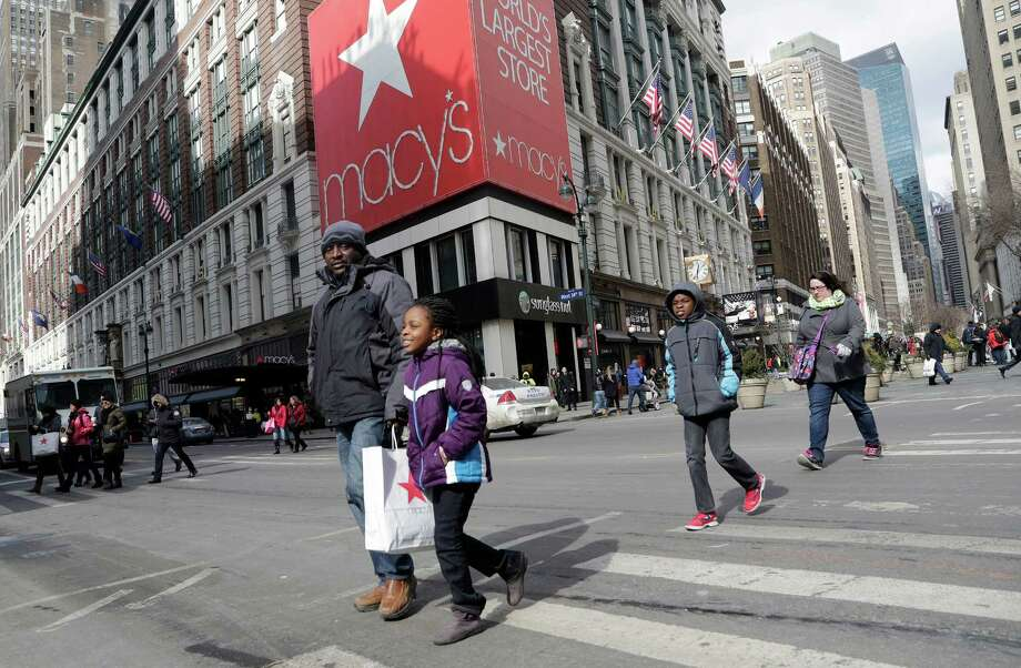 Shoppers depart Macy's New York flagship store in February 2015. Macy's this week kicked off the first-quarter earnings season for major retailers.  Photo: Mark Lennihan, STF / Copyright 2016 The Associated Press. All rights reserved. This material may not be published, broadcast, rewritten or redistribu