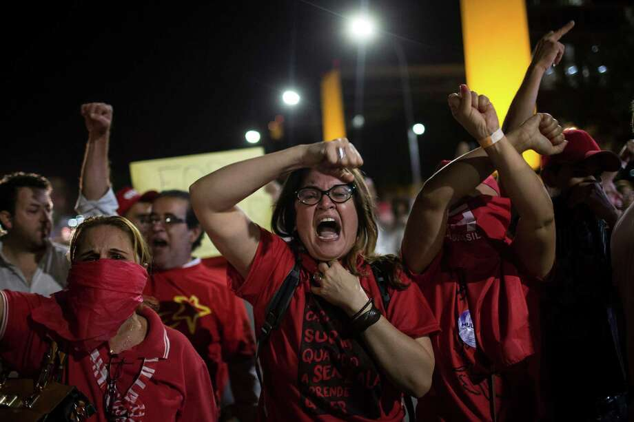Brazilians who support President Dilma Rousseff shout during clashes with police on the lawn outside the Senate as senators debated whether to impeach her. Photo: Felipe Dana / Associated Press / AP
