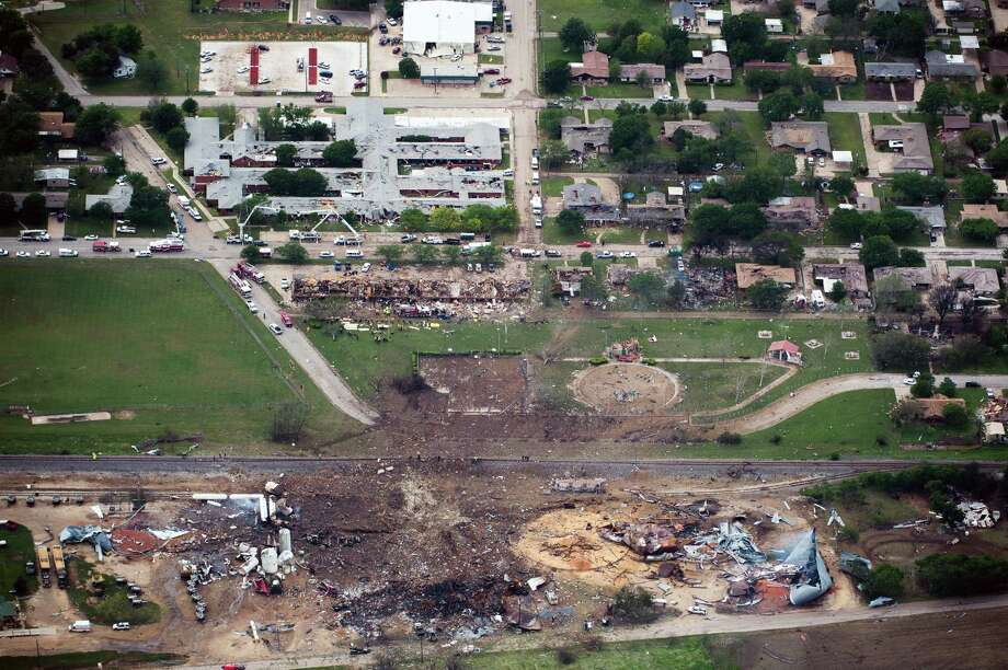 Damage from the explosion of the West Fertilizer plant is seen in an aerial view of the city on Thursday, April 18, 2013, in West, Texas.  The plant is a the bottom of the photo.  An apartment complex is at center.  A nursing home is at top.  ( Smiley N. Pool / Houston Chronicle ) Photo: Smiley N. Pool, Staff / Houston Chronicle / © 2013  Houston Chronicle