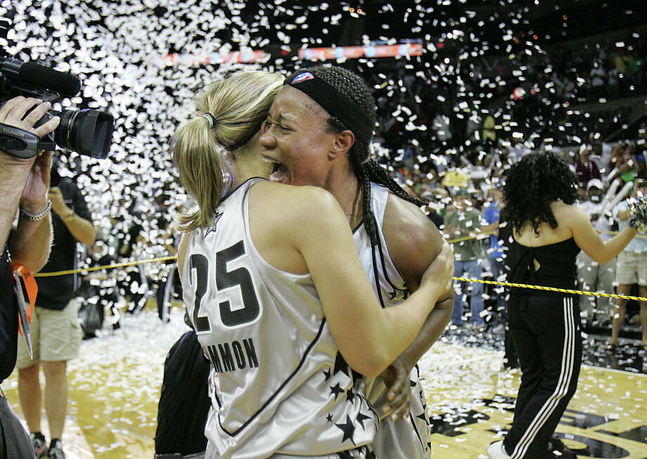 Silver Stars' Becky Hammon and Vickie Johnson celebrate under confetti that fell after defeating the Los Angeles Sparks 76-72 during Game 3 of the WNBA Western Conference finals at the AT&T Center on Sept. 28, 2008. Photo: Express-News File Photo / delopez@express-news.net