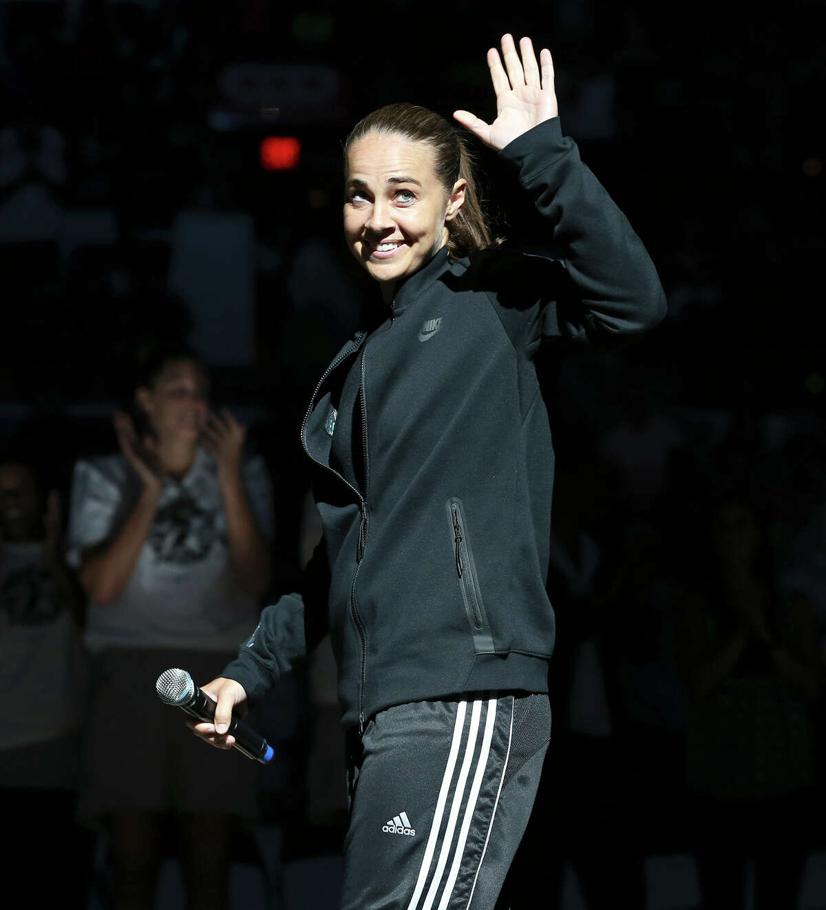Becky Hammon waves to the fans during her retirement ceremony as the Stars play the Minnesota Lynx in the last regular season home game of the year on Aug. 15, 2014.