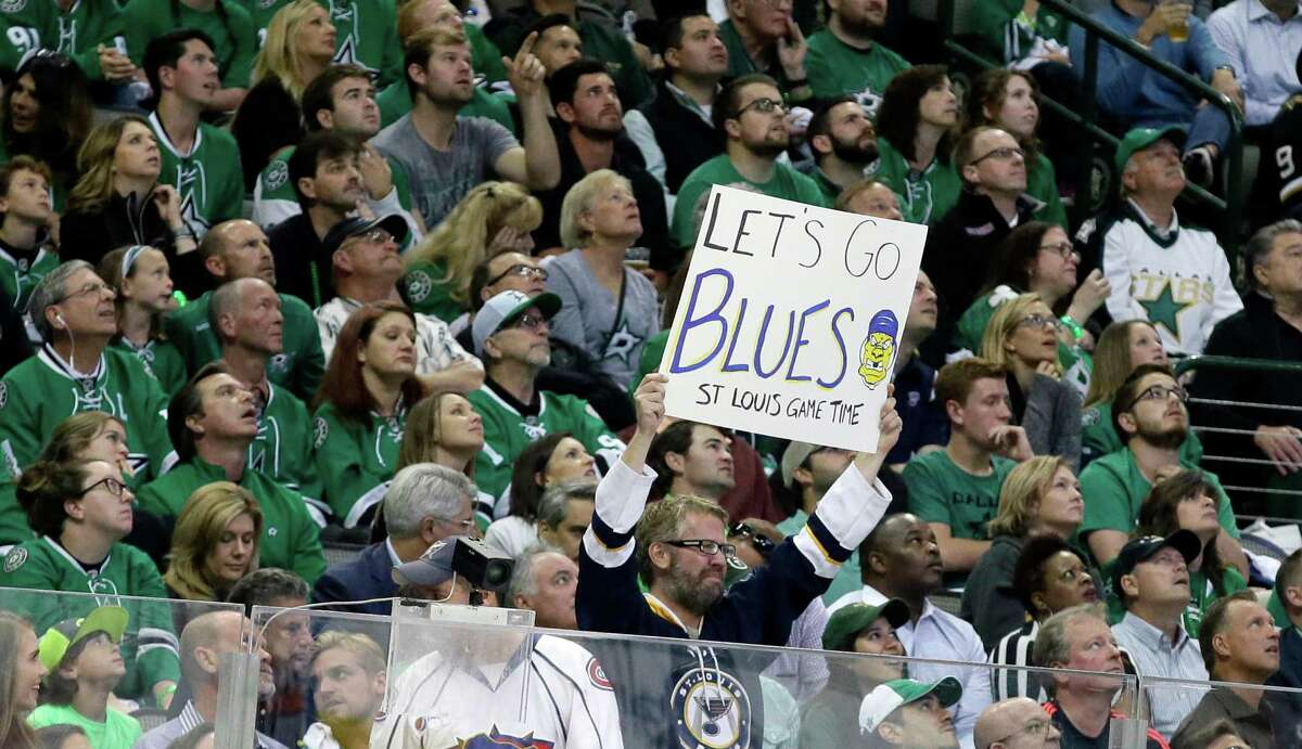 A St. Louis Blues fan holds up a sign among Dallas Stars fans during the first period of Game 7 of the NHL hockey Stanley Cup Western Conference semifinals Wednesday, May 11, 2016, in Dallas.