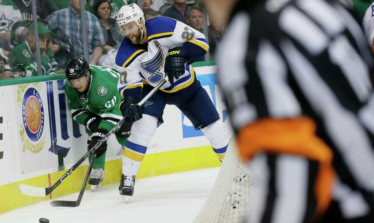 St. Louis Blues defenseman Alex Pietrangelo (27) and Dallas Stars center Cody Eakin (20) chase the puck during the first period of Game 7 of the NHL hockey Stanley Cup Western Conference semifinals Wednesday, May 11, 2016, in Dallas.