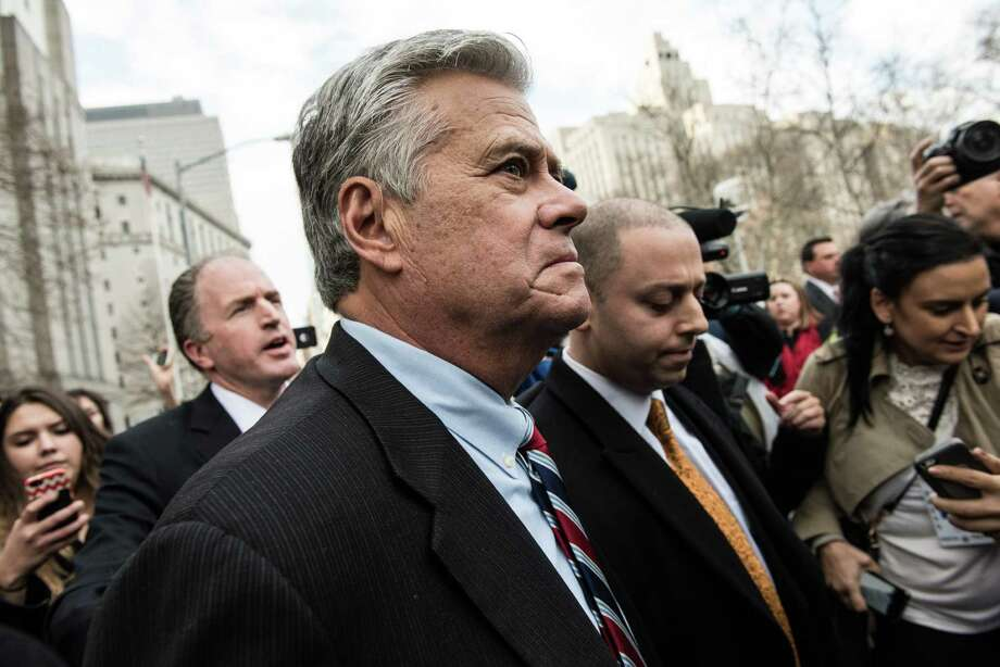 File - Dean Skelos, the former New York State Senate majority leader, and his son Adam Skelos, right, leave federal court after being found guilty on all counts at their corruption trial in New York, Dec. 11, 2015. Skelos and his son Adam will face sentencing on federal corruption charges in Manhattan at 10:30 a.m. Thursday. (Andrew Renneisen/The New York Times) Photo: ANDREW RENNEISEN / NYTNS
