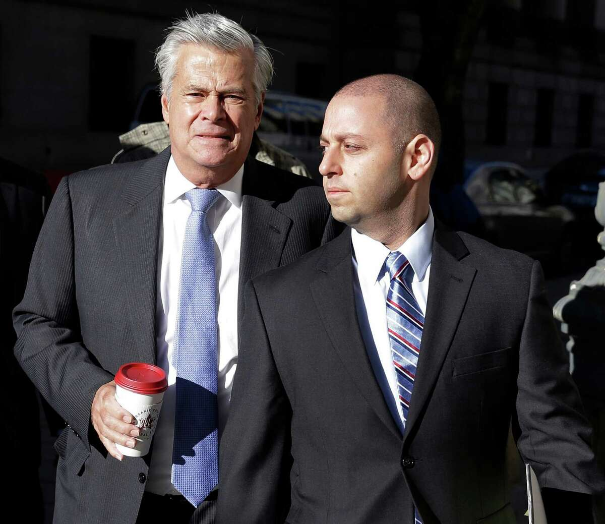 FILE - In this Nov. 17, 2015, file photo, New York Sen. Dean Skelos, left, and his son Adam Skelos arrive to court for jury selection in the pair?'s extortion trial, in New York. Dean Skelos and his son Adam will face sentencing on federal corruption charges in Manhattan at 10:30 a.m. Thursday.(AP Photo/Seth Wenig)