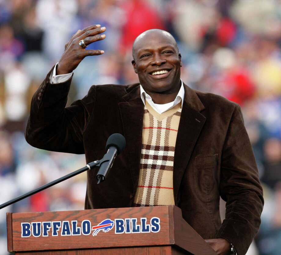 FILE - In this Nov. 29, 2009, file photo, former Buffalo Bills defensive end Bruce Smith smiles during his Hall of Fame ring ceremony at halftime of an NFL football game between the Bills and the Miami Dolphins in Orchard Park, N.Y. The Bills will retire Bruce Smith's No. 78 at the home opener this fall. The team announced Wednesday, May 11, 2016,  that the Hall of Fame defensive end be honored with a jersey retirement ceremony to take place in during halftime of the Bills' prime-time game against the New York Jets on Sept. 15. (AP Photo/ Dean Duprey, File) ORG XMIT: NY152 Photo: Dean Duprey / AP2009