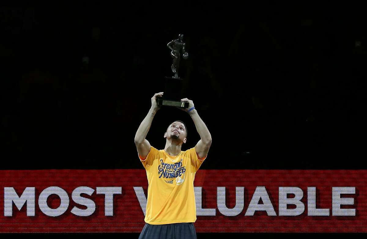 Stephen Curry raises his MVP trophy up before game 5, round 2 of the NBA playoffs featuring the Warriors against the Trail Blazers at the Oracle Arena May 11, 2016 in Oakland, Calif.