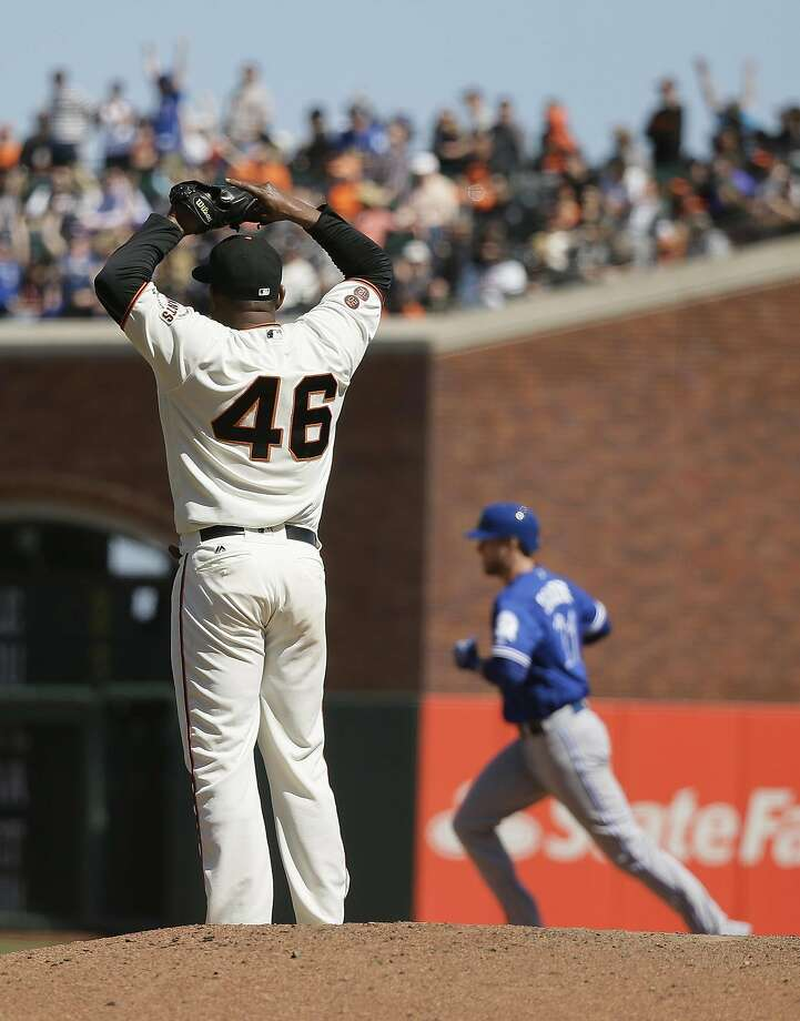 Toronto Blue Jays' Michael Saunders, right, circles the bases after hitting a home run off San Francisco Giants relief pitcher Santiago Casilla, left, in the ninth inning of their baseball game Wednesday, May 11, 2016, in San Francisco. (AP Photo/Eric Risberg) Photo: Eric Risberg, Associated Press