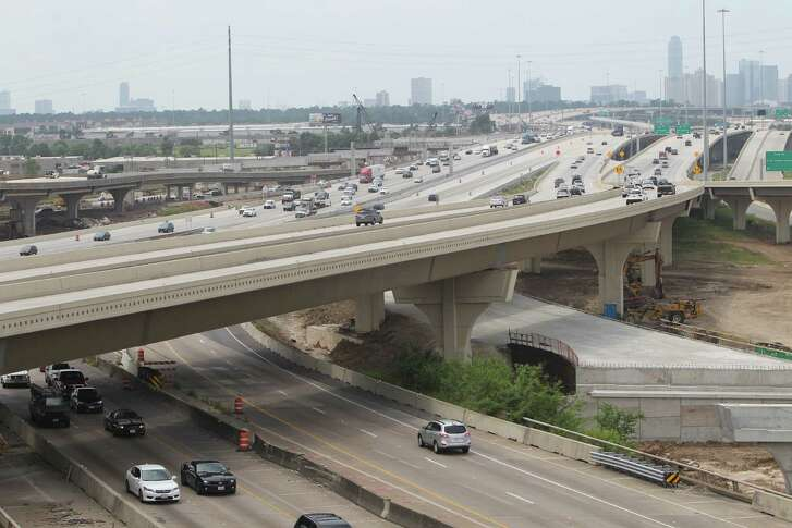 """An overview of the TxDOT construction of US 290 and Loop 610 Wednesday, May 11, 2016, in Houston.  TxDOT will make a major traffic switch this weekend, changing the way drivers get from northbound Loop 610 to U.S. 290. """"We will switch the exit to US 290 from its current location on the left side of the freeway to the right side of the freeway.  The exit will be placed on a portion of the new IH 10 to US 290 connector, the part that is completed is from about W. 18th Street over to US 290.  So we'll move the US 290 exit to that portion of the connector with a temporary transition from the right side of IH 610 to the connector.  What this does is open up the US 290 westbound mainlanes from IH 610 to about W. 34th for crews to work on.""""  ( Steve Gonzales  / Houston Chronicle  )"""