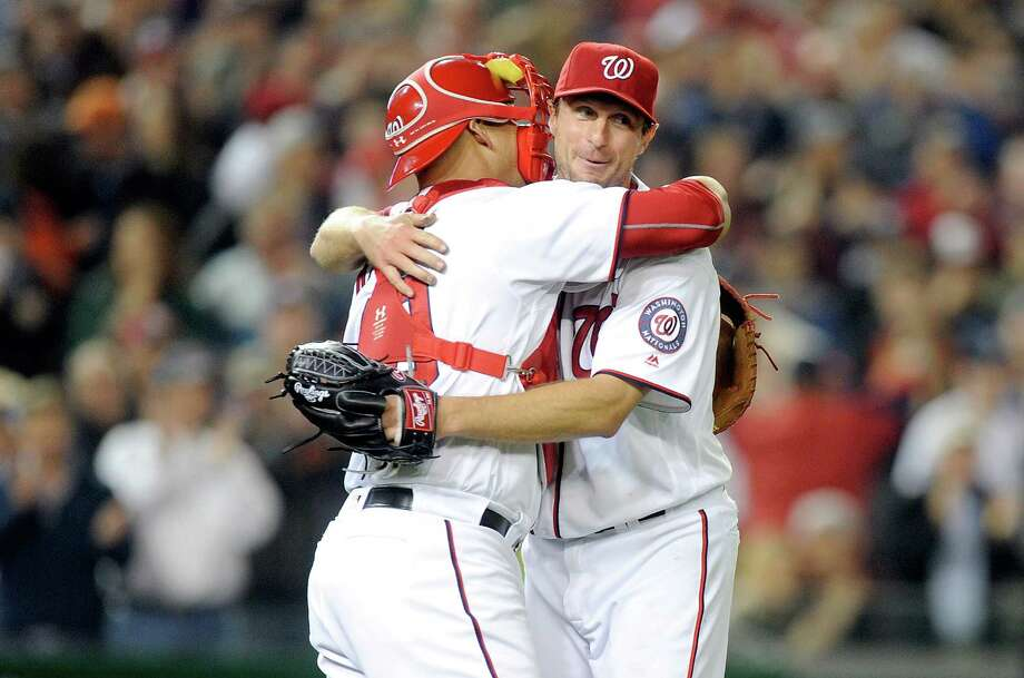 Max Scherzer, right, celebrates his 20-strikeout feat with catcher Wilson Ramos on Wednesday night. Photo: Greg Fiume, Stringer / 2016 Getty Images