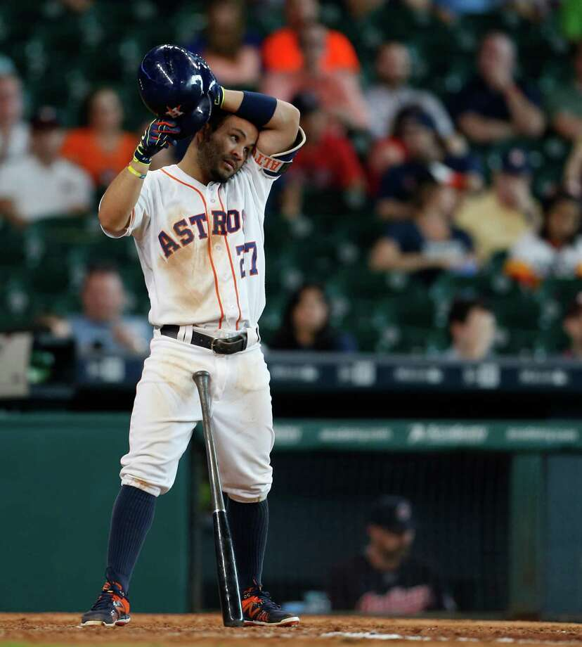 Jose Altuve, who has been the Astros' best player during their ragged start, gathers himself during the marathon game. Photo: Karen Warren, Staff / © 2016 Houston Chronicle