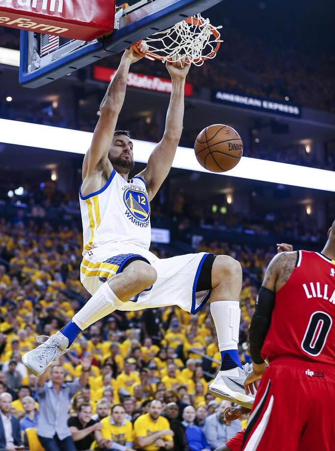 Golden State Warriors Andrew Bogut dunks in the first quarter during Game 5 of the NBA Playoffs at Oracle Arena on Wednesday, May 11, 2016 in Oakland. Photo: Scott Strazzante, The Chronicle