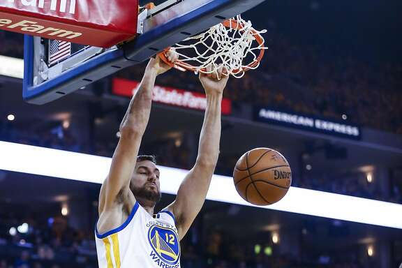 Golden State Warriors Andrew Bogut dunks in the first quarter during Game 5 of the NBA Playoffs at Oracle Arena on Wednesday, May 11, 2016 in Oakland, Calif.