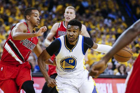 Golden State Warriors Leandro Barbosa drives past Portland Trail Blazers C.J. McCollum in the first quarter during Game 5 of the NBA Playoffs at Oracle Arena on Wednesday, May 11, 2016 in Oakland, Calif.