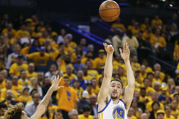 Golden State Warriors Klay Thompson shoots a second quarter 3-pointer during Game 5 of the NBA Playoffs at Oracle Arena on Wednesday, May 11, 2016 in Oakland, Calif.