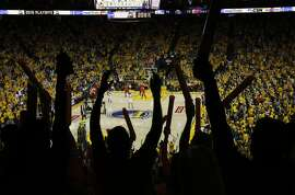Fans cheer after Stephen Curry tied up the game when he made a three-pointer during game 5, round 2 of the NBA playoffs featuring the Warriors against the Trail Blazers at the Oracle Arena May 11, 2016 in Oakland, Calif.