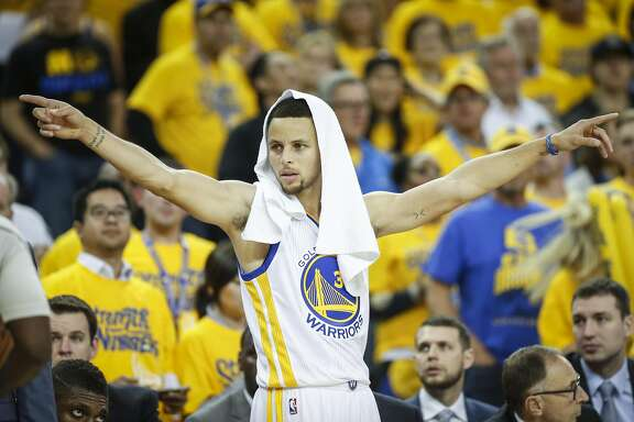 Golden State Warriors Stephen Curry is seen on the sideline in the third quarter during Game 5 of the NBA Playoffs at Oracle Arena on Wednesday, May 11, 2016 in Oakland, Calif.