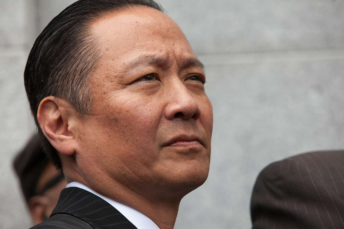 Public defender Jeff Adachi listens in during a news conference outside the Hall of Justice on Wednesday, May 11, 2016 in San Francisco, Calif.