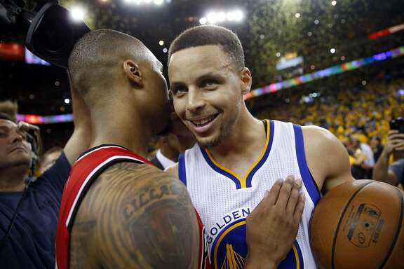 Golden State Warriors'Stephen Curry is congratulated by Portland Trail Blazers' Damian Lillard after Warriors' 125-121 win in Game 5 of NBA Playoffs' Western Conference Semifinals at Oracle Arena in Oakland, Calif., on Wednesday, May 11, 2016.